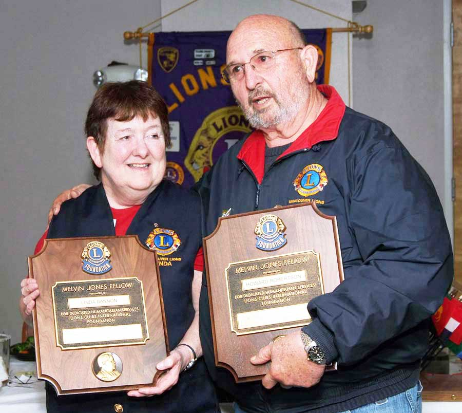 picture of Ned Olson and Linda Bannon holding Melvin Jones fellowship plaques