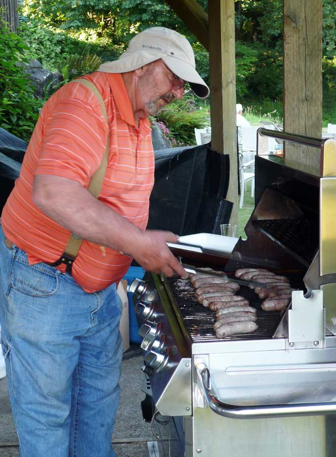 picture of Ned Olson cooking at a club picnic
