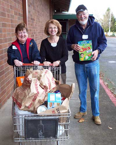 group picture of club members working at the walk and knock food drive